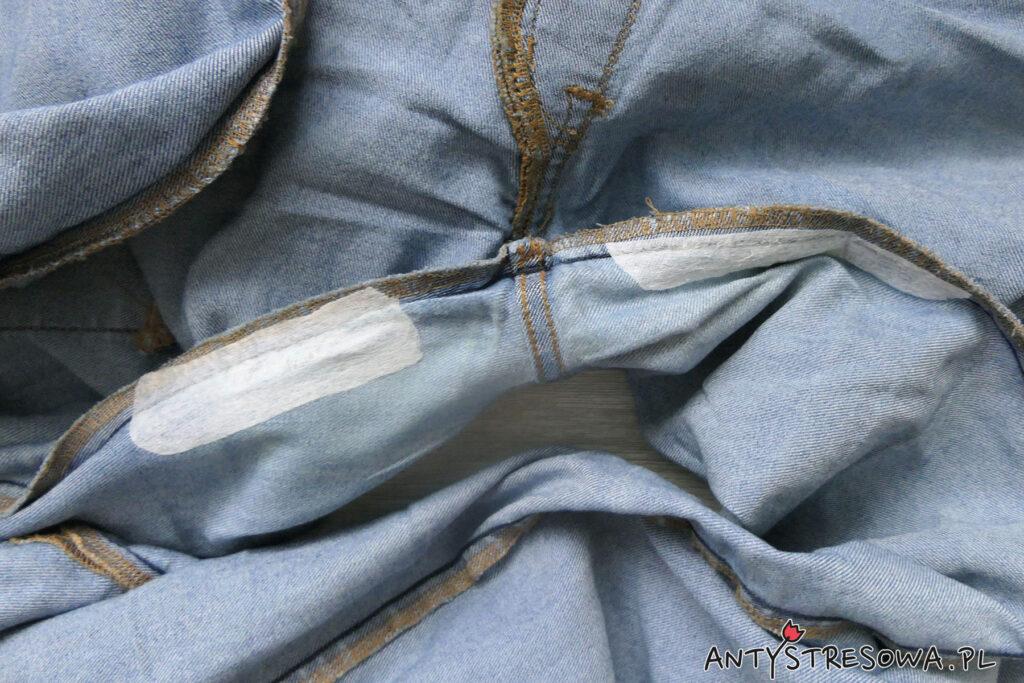 Łatanie dziur w jeansach za pomocą fizeliny